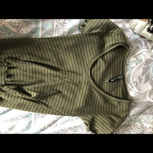 Green t with black stripes